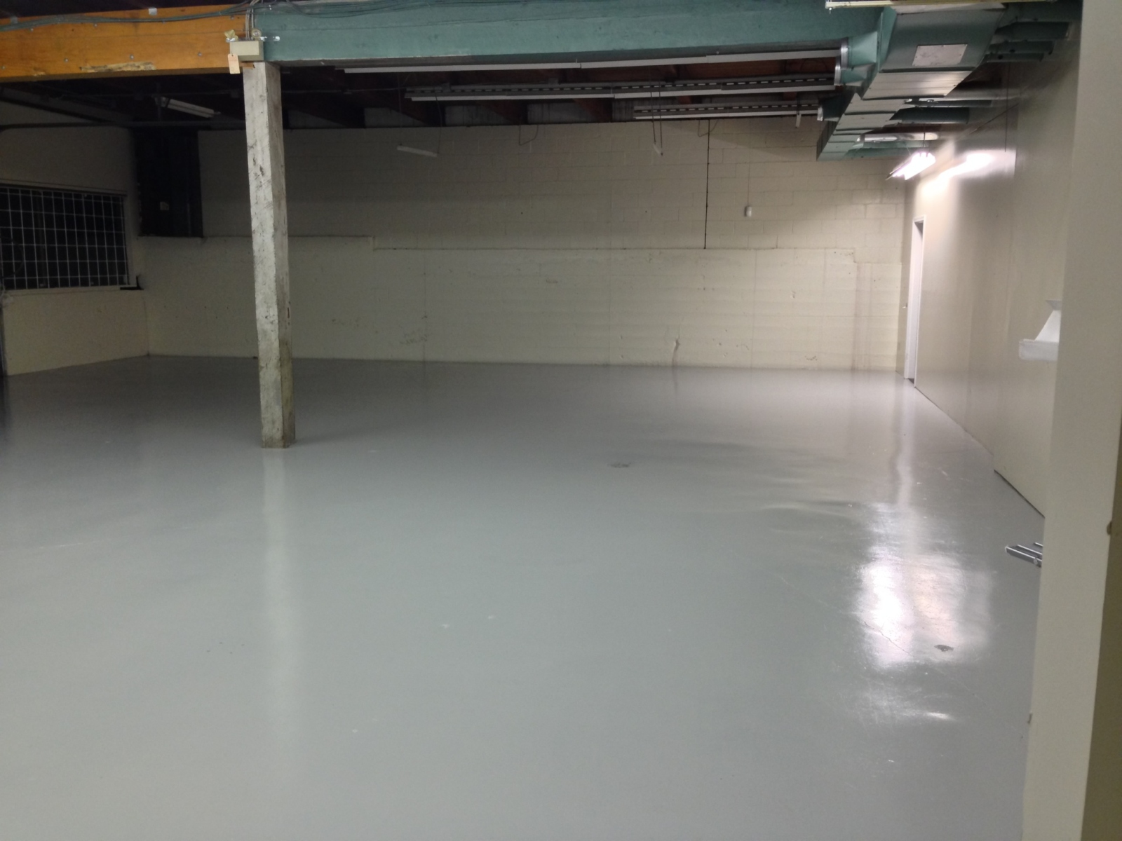 Epoxy Floor After Vanguard Painting.jpg